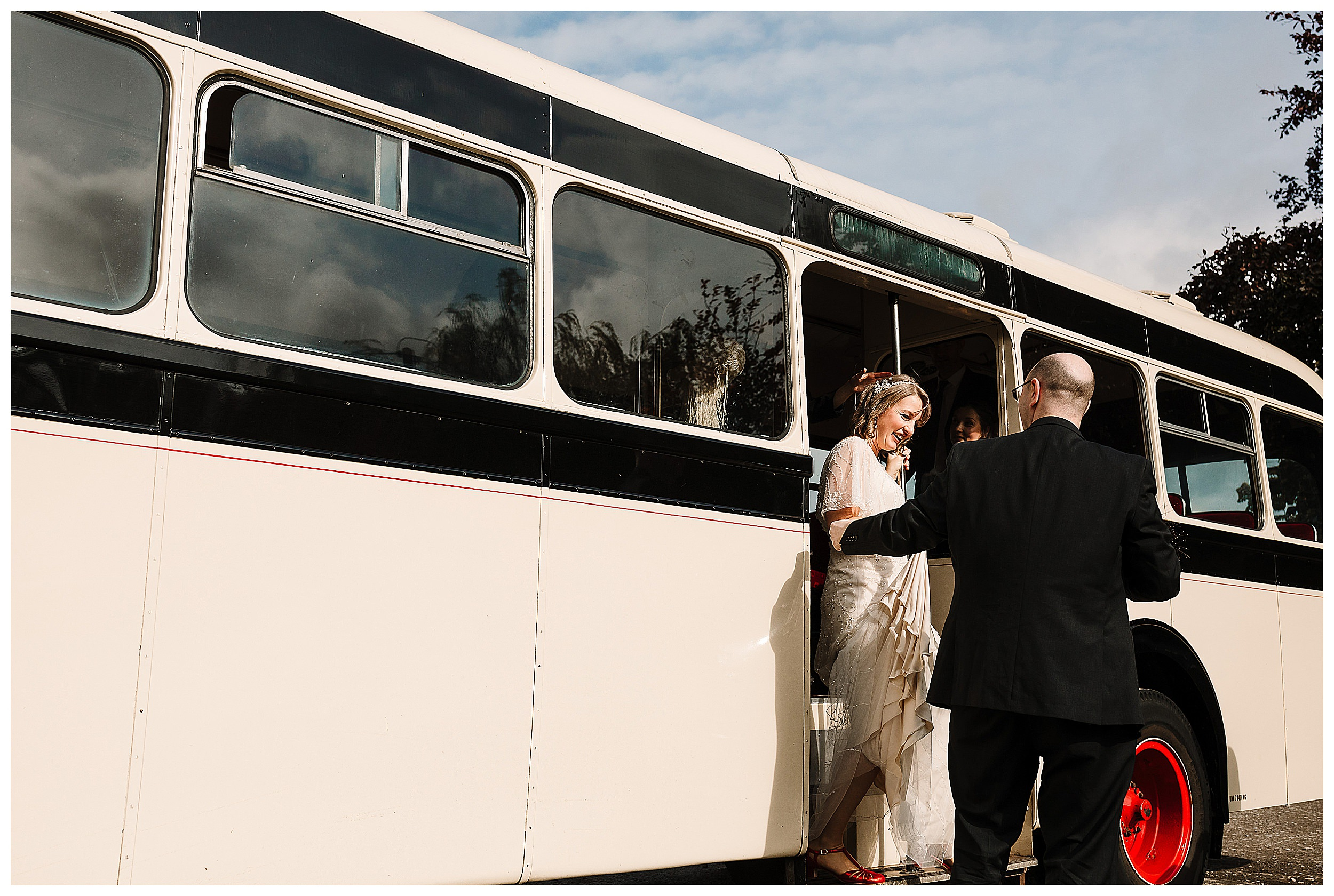 A bride stepping off a vintage bus