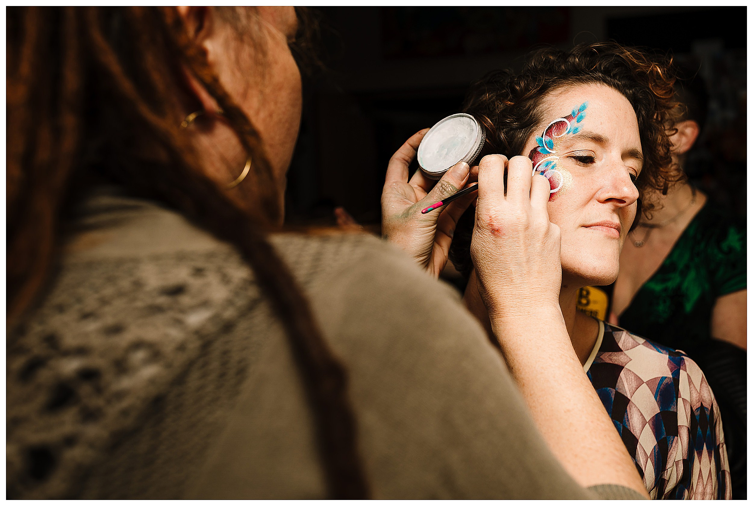 A wedding guest having her face painted