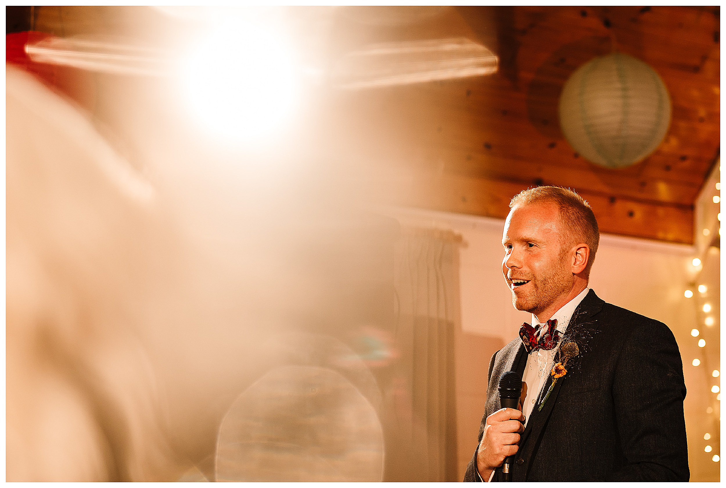 A groom doing his speech into a microphone