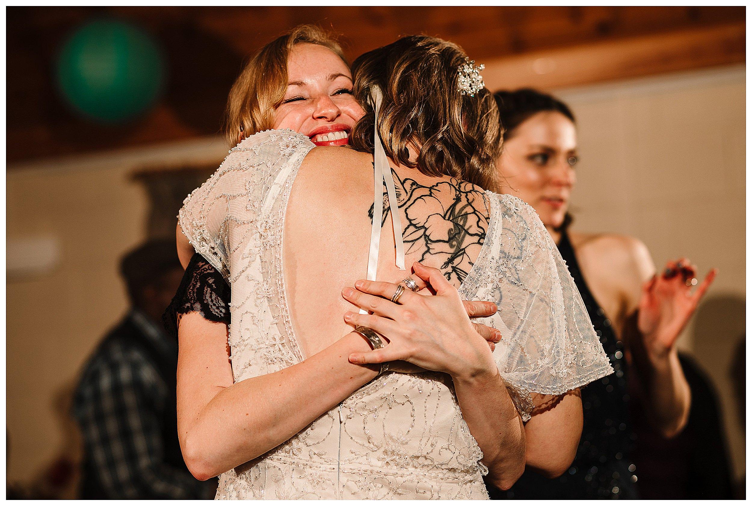 A bride hugging her friend