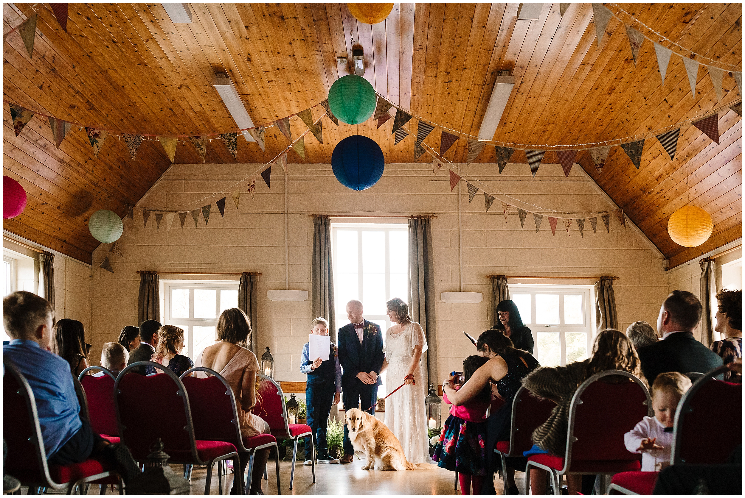 A young boy doing a reading during a village hall wedding