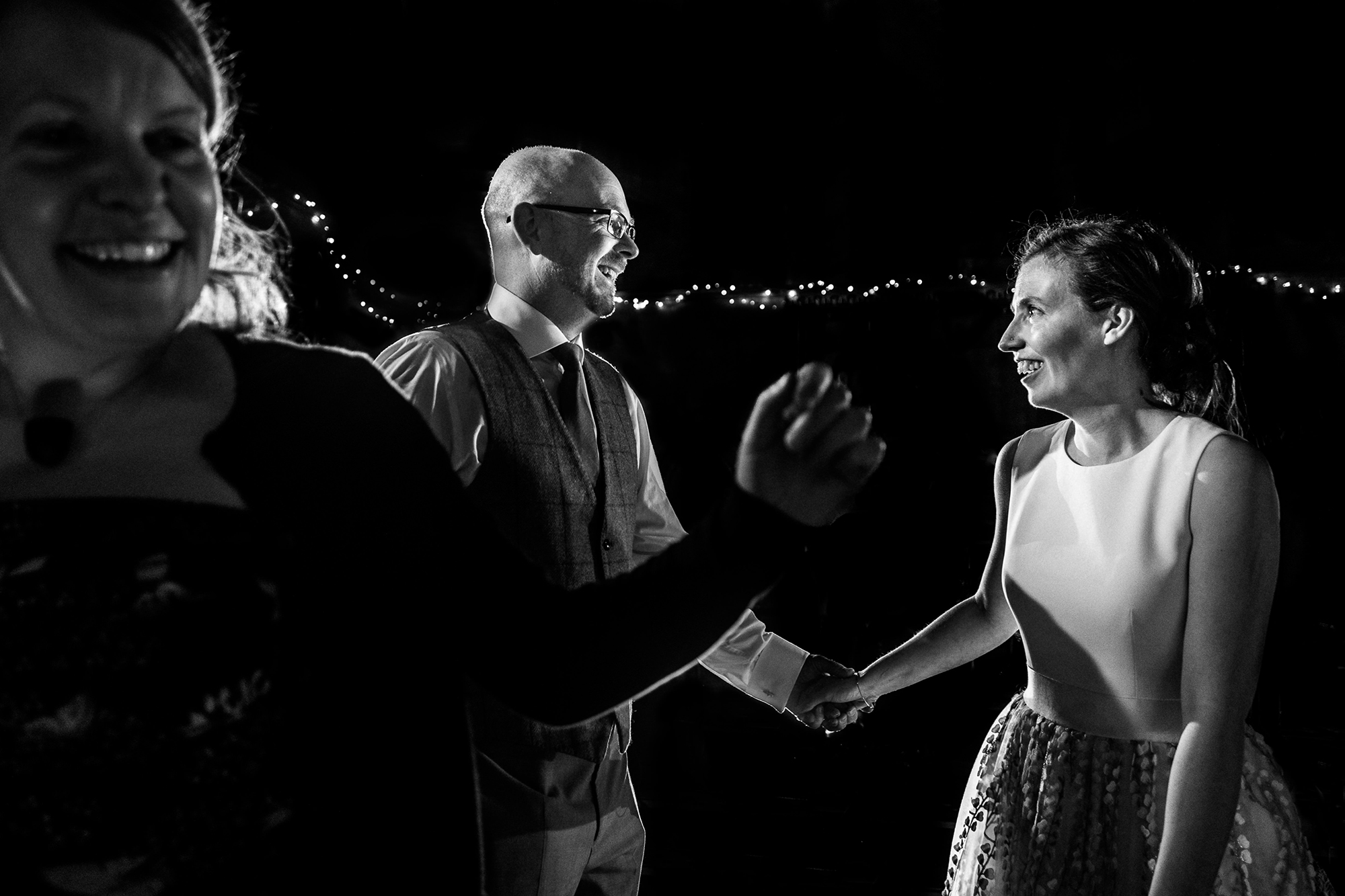 A black and white image of a bride and groom dancing
