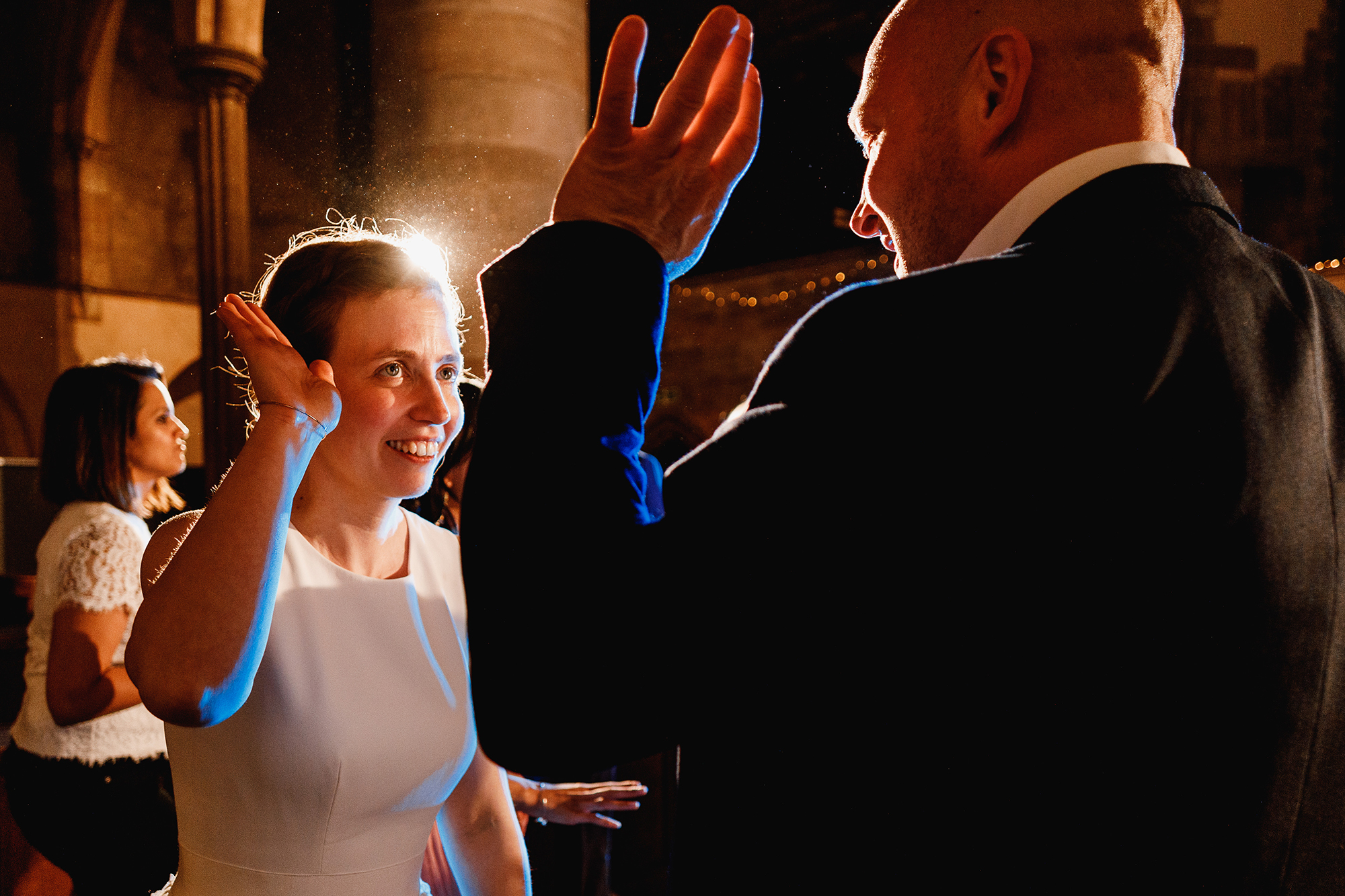 A bride giving a high five to a wedding guest