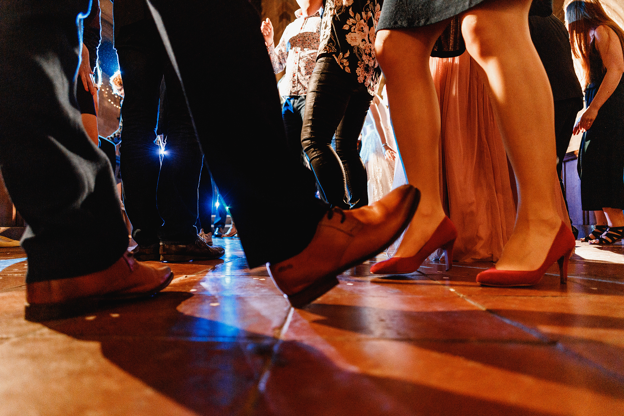 A low angle image of feet dancing at a wedding reception