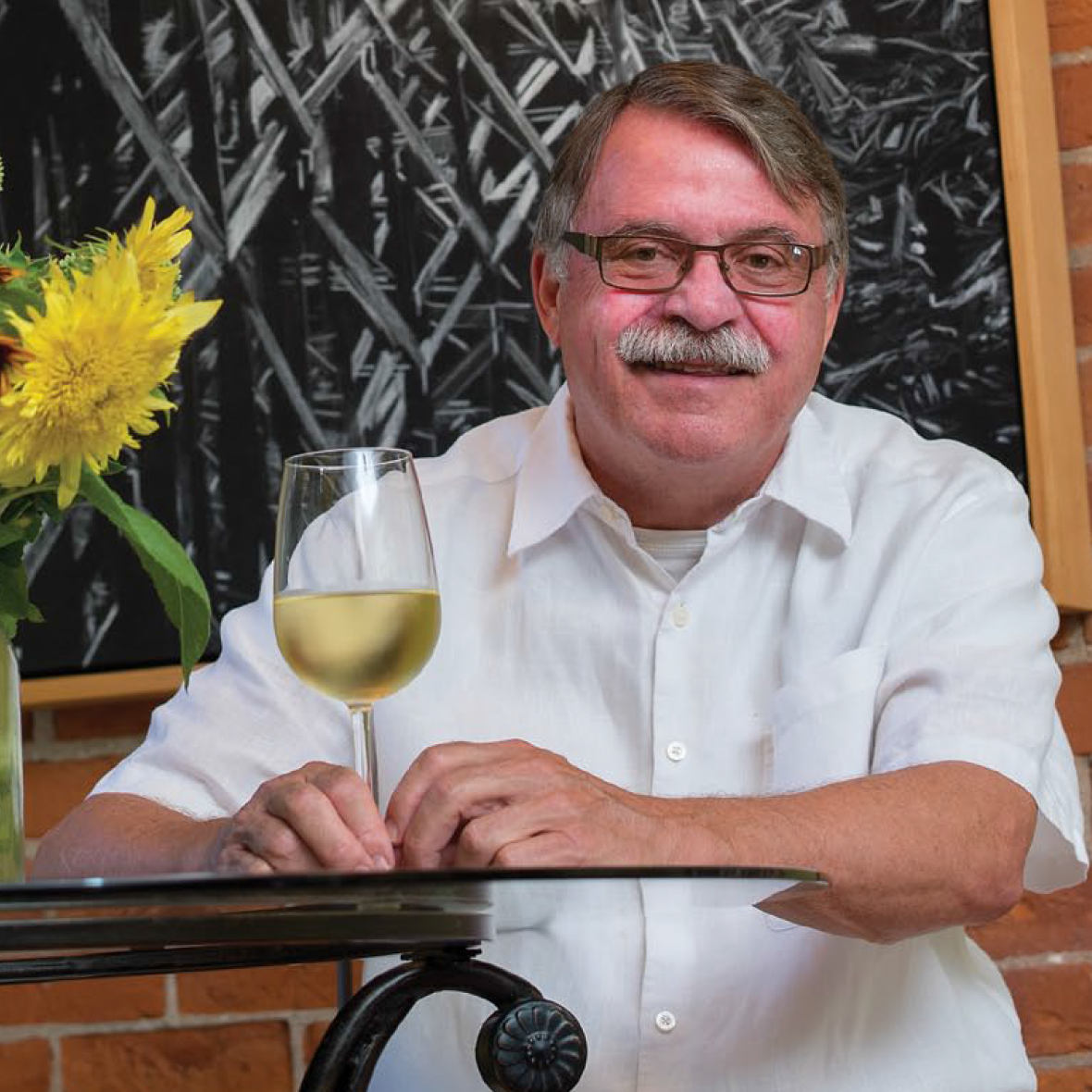 PHILOSOPHER BUSINESSMAN - Busy restaurateur lives intentional life committed to environmentalism as well as a culinary flairGrand Magazine, November-December 2017