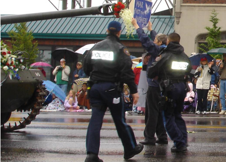 Bonnie Tinker being arrested.