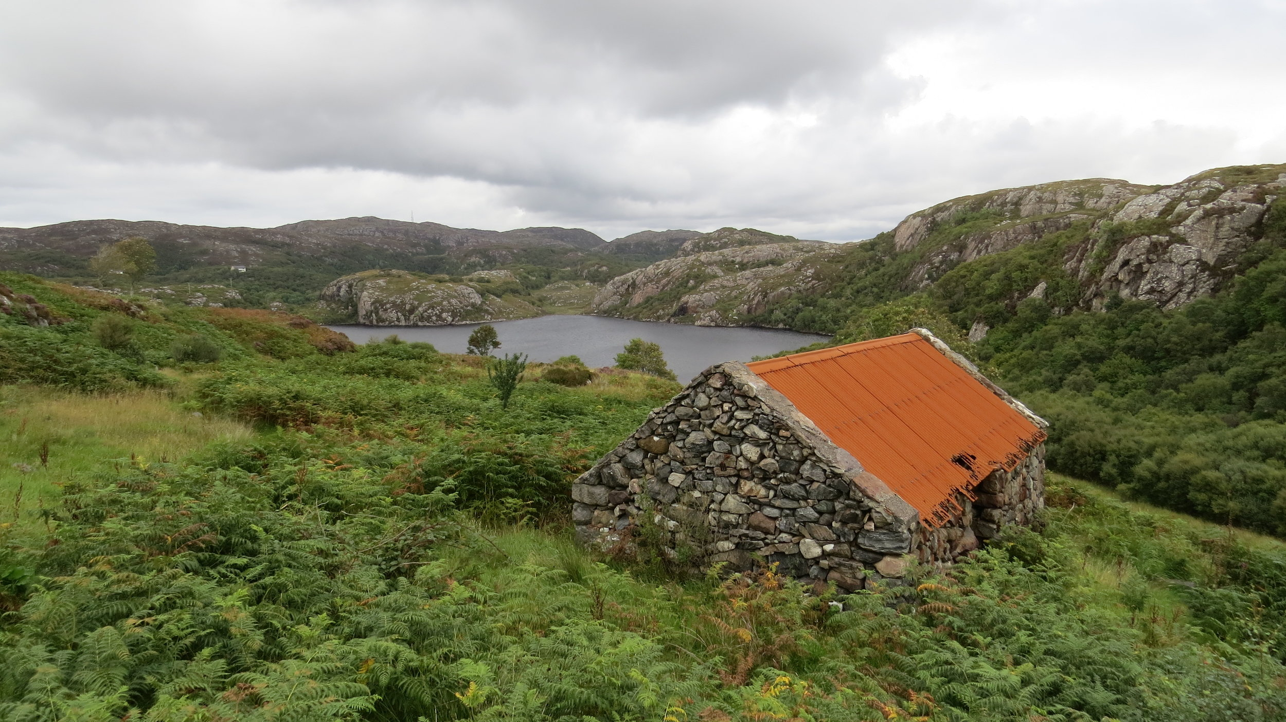 Rust roof in front of Loch Dubh