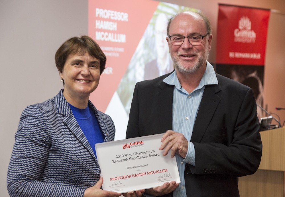 Professor Hamish McCallum receives his Research Leadership Award from VC and President Professor Carolyn Evans. Photo credit: Griffith University