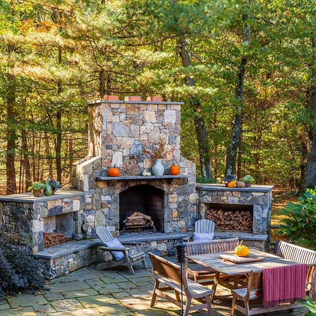 It's getting chilly around here!  Having a fireplace on your patio keeps the party warm year round. (📸 by bdw_photography) #newenglandlandscapes #fieldstone #outdoorfireplace🔥 #designandbuild #autumnlandscape🍁🍂🌿 #Medfield
