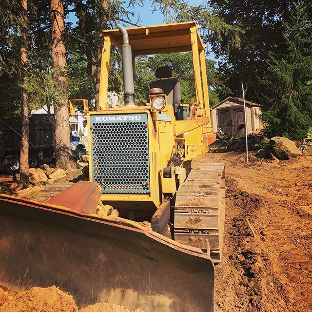 Vehicle of change. #newenglandlandscaping #dozer #backyardproject #oakwoodslandscaping #makeitbeautiful #makeituseful