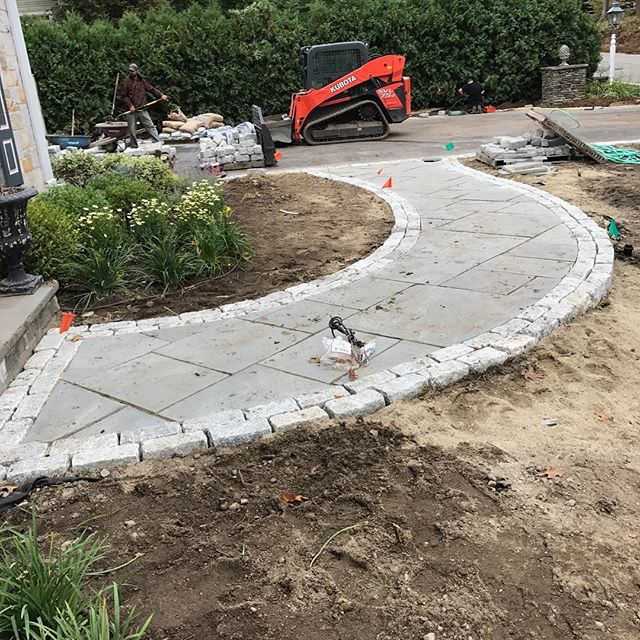 In progress!  New bluestone walkway with double cobblestone borders.  This is a full front and backyard transformation with some of the nicest clients -- more pictures to come soon!  #newenglandlandscaping #landscapedesign #hardscaping #justapeek