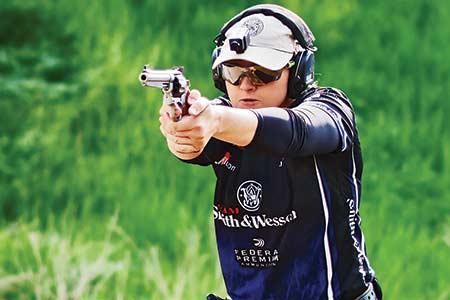 Julie Golob, captain of Team S&W, shoots a Performance Center Model 929 loaded with Federal American Eagle 9mm 147-grain ammo.