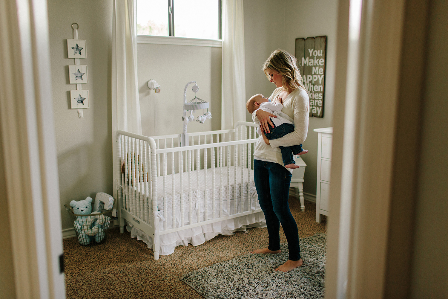 Lifestyle photograph of mom and baby in home