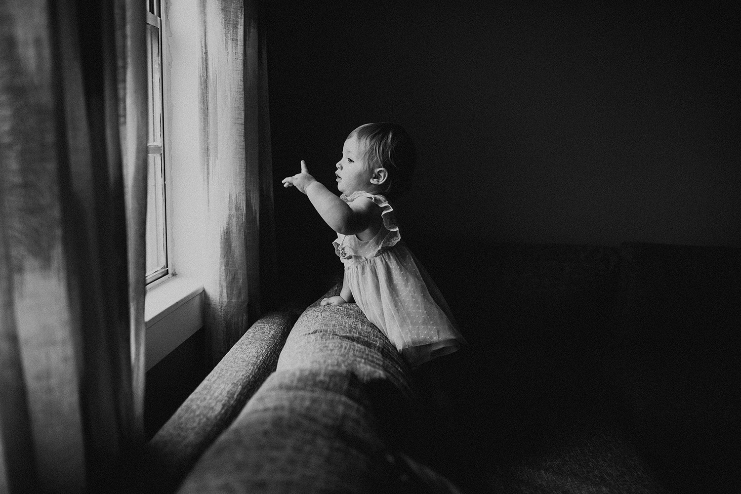 Baby at window in lifestyle session