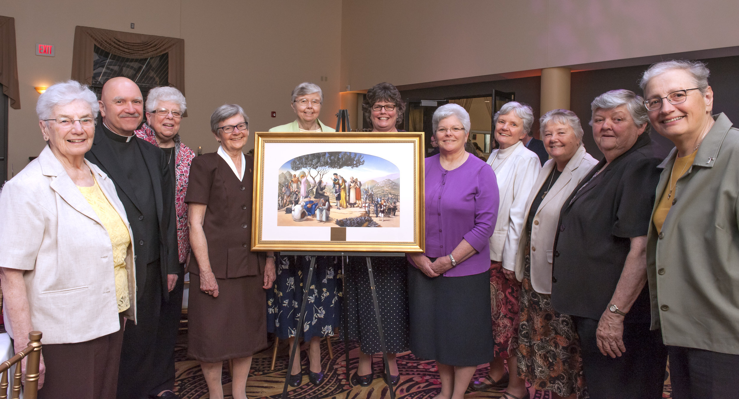 Fr. Joe Genito, OSA (second from left) awarding the Peace Award to Sr. Marie Lucey and the Franciscan Sisters of Philadelphia in 2017.