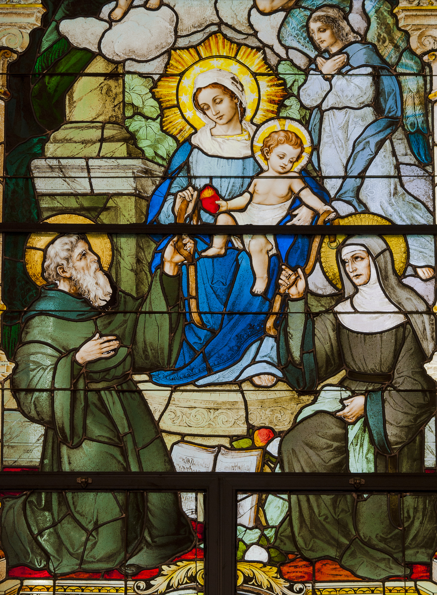 Our Mother of Consolation - bestows upon St. Augustine and his mother, St. Monica, the cincture, as a sign of her promise to intercede on their behalf before God.The Christchild holds a heart on fire, the restless heart of St. Augustine.