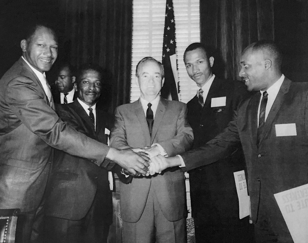 Tom Bradley shakes hands with Vice President Hubert Humphrey.