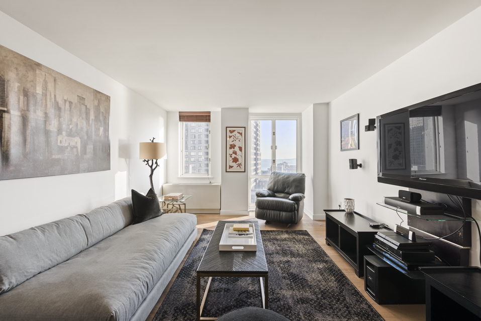225 Rector Place: 15E - $940,000 // 1 Bed // 1 Bath // 687 SQFTA luminous condo boasts a stunning view of lower Manhattan and the Upper Bay showcasing the Statue of Liberty, this high-floor 1-bedroom, 1-bathroom is an exemplar of modern city living.
