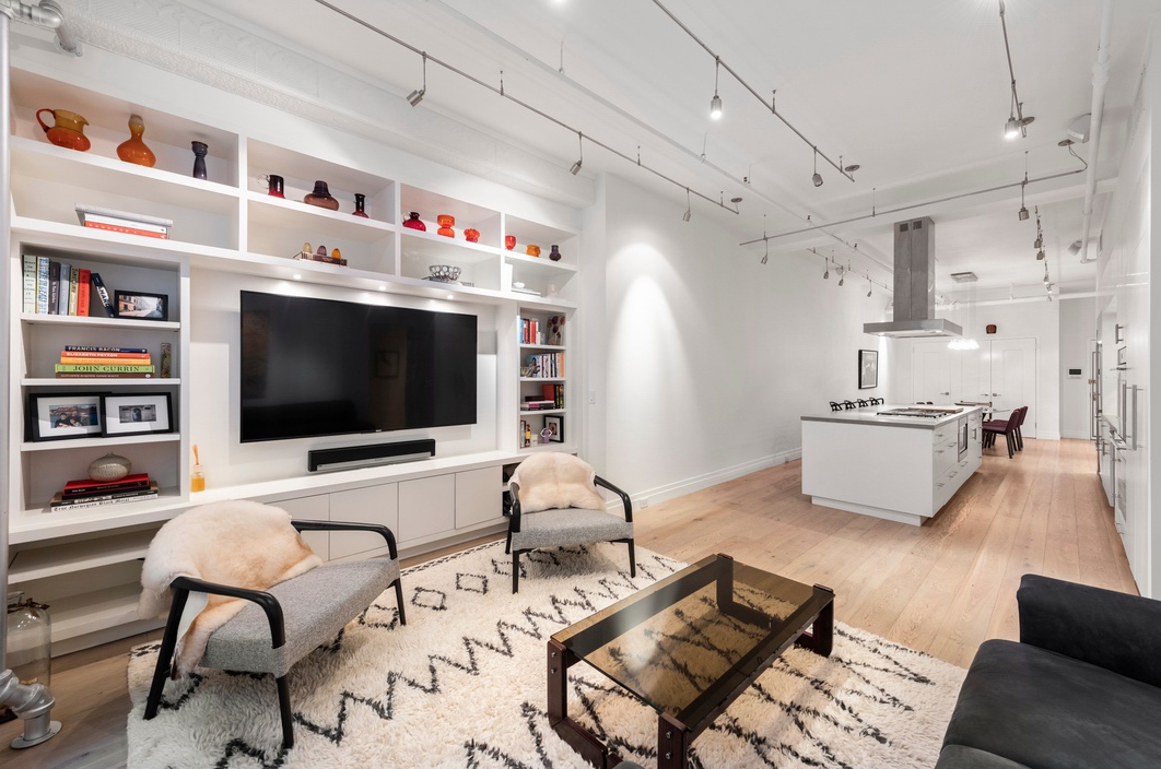 107 WEST 25TH STREET, 3B - $1,850,000 // 2 Beds // 2 Baths // 1,200 SQFTA pristine Chelsea loft located less than two blocks from Madison Square Park, this gut-renovated 1-bedroom + home office or nursery, 2-bathroom co-op is a paradigm of contemporary city living.