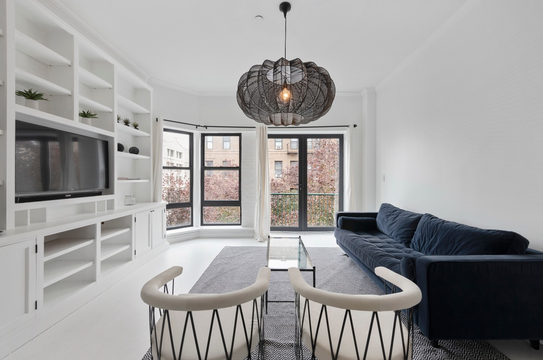 """98 HAVEMEYER STREET, 8A - $1,400,000 // 2 Beds // 1 Bath // 852 SQFTThis newly renovated home features a smart redesign with modern finishes. Main highlights include the lofted 9'10"""" ceilings and floor to ceiling windows that allow an abundance of natural light to flood the apartment throughout the day. The open floorplan is complete with private balcony, beautiful French doors, central air/heat through smart Nest system, and an AMAZING private 852 square foot rooftop terrace with city and bridge views. This is Brooklyn living at its best."""