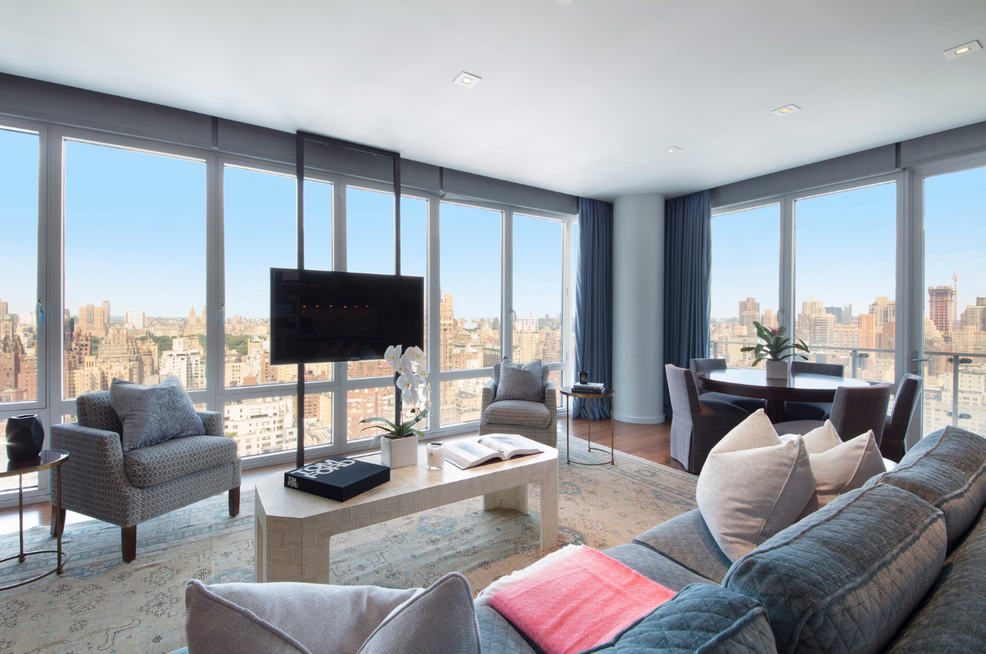 255 EAST 74TH STREET, 29B - $5,000,000 // 4 Beds // 3.5 Baths // 2,487 SQFT // 106 EXSFGraced with an array of sleek finishes and sublime city views, this 4-bedroom, 3.5-bathroom floor-through condo is an exemplar of contemporary UES luxury. Features of this 2,487 sq. ft. home include gorgeous hardwood floors in the living spaces, elegant carpeting in the bedrooms, huge floor-to-ceiling windows, northern, eastern, and western exposure, soaring 10-ft ceilings, innovative TV window mounts, a convenient in-unit washer/dryer, a [wood/gas]-burning fireplace, a spacious balcony with views that stretch from Queens and the East River to the treetops of Central Park and beyond.