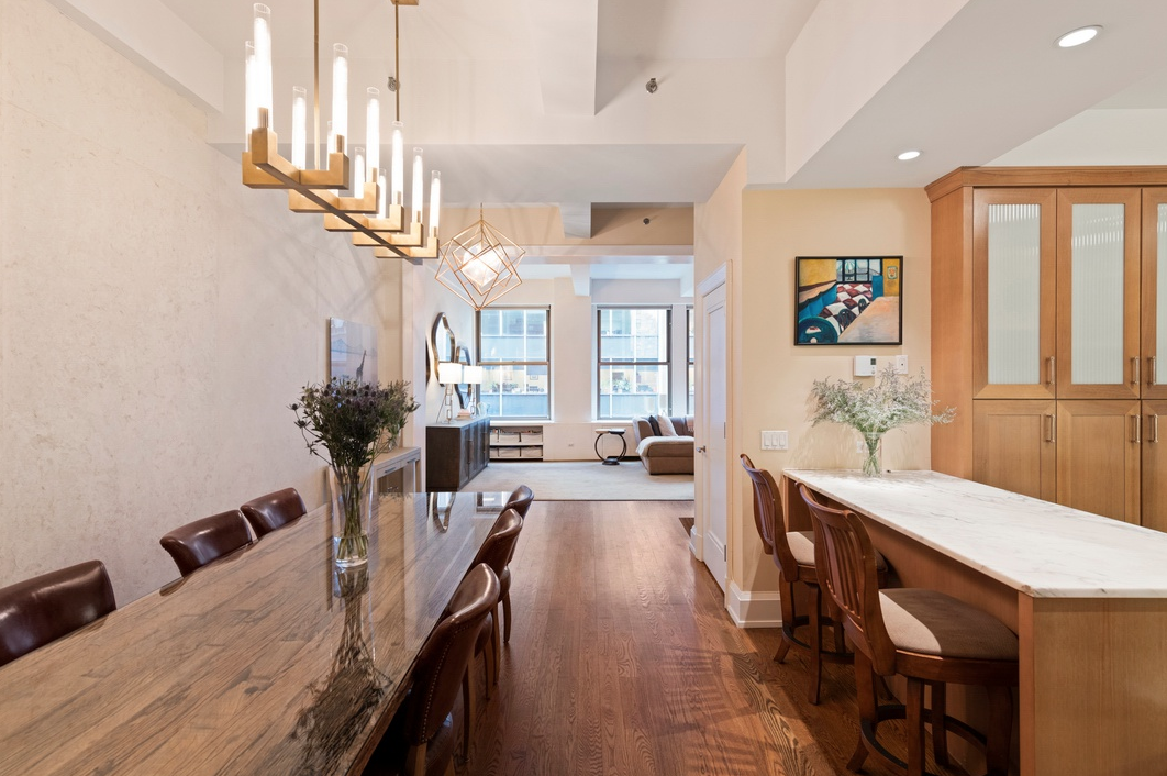 31 EAST 28TH STREET, 4W - $2,500,000 // 2 Beds // 2 Baths // 1,805 SQFTA pristine floor-through condo situated in the heart of NoMad, this lovely 2-bedroom, 2-bathroom home is the quintessence of classic city living. Features of this 1,805 sq. ft. apartment include gorgeous hardwood floors, an open layout dramatized by 11-ft beamed ceilings, huge windows with northern and southern exposure, direct elevator access, and a convenient in-unit washer/dryer fro Bosch.