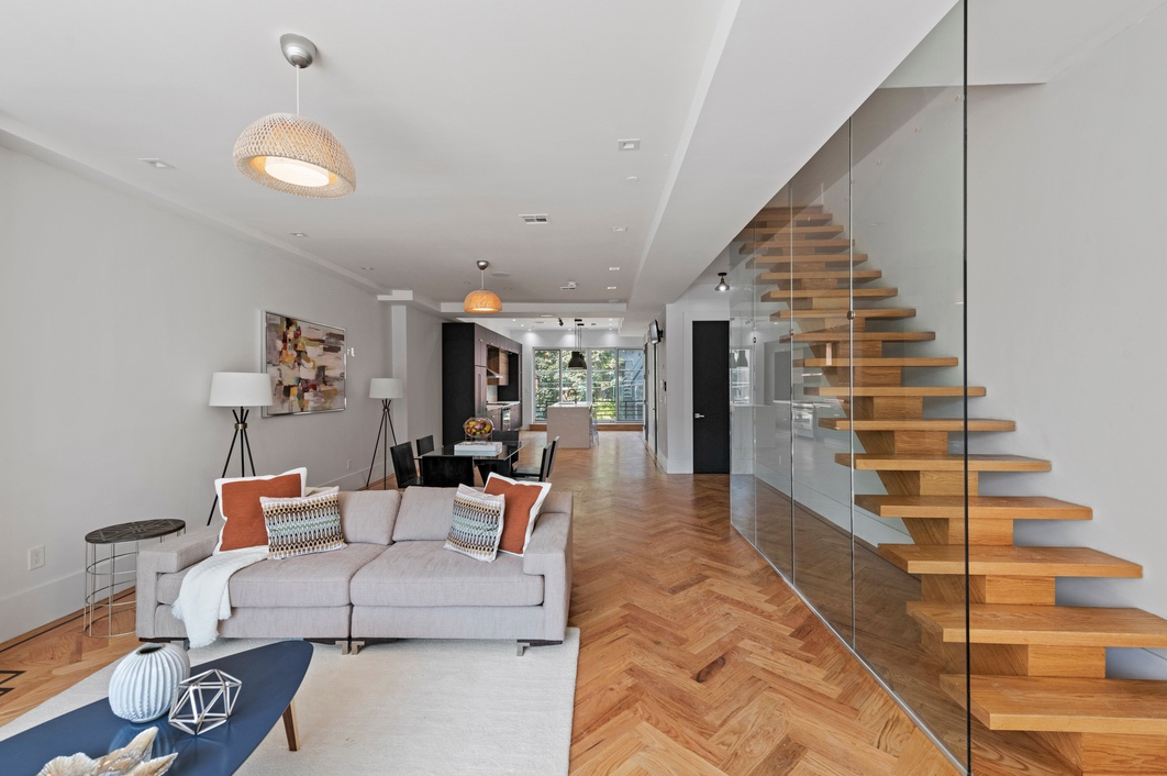 453 LEXINGTON AVENUE - $1,999,000 // 6 Beds // 5 Baths // 3,485 SQFTA gut-renovated two-family townhouse nestled in the heart of Bedford-Stuyvesant, 453 Lexington is a portrait of contemporary Brooklyn living. Features of the home include gorgeous hardwood floors, northern and southern exposure, a traditional redbrick façade, central heating and cooling, charming decorative fireplaces, a fenced-in backyard, a finished cellar, and an income-producing rental unit.