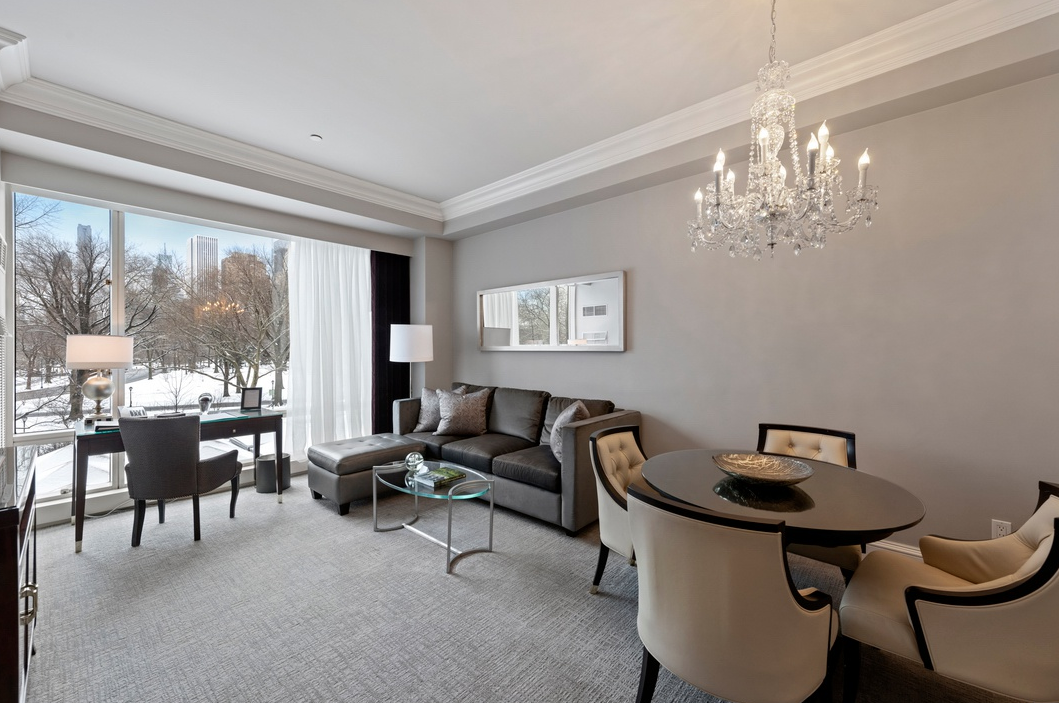 1 CENTRAL PARK WEST, 302-303 - $2,800,000 // 2 Beds // 2 Baths // 1,182 SQFTA pristine condo situated on Columbus Circle and Central Park, this renovated 2-bedroom, 2-bathroom home blends luxury hotel amenities with stunning park views and a prime Lincoln Square location. Features of this 1,182 sq. ft. unit include floor-to-ceiling windows with eastern exposure, direct park views, carpeted flooring, and central heating and cooling.