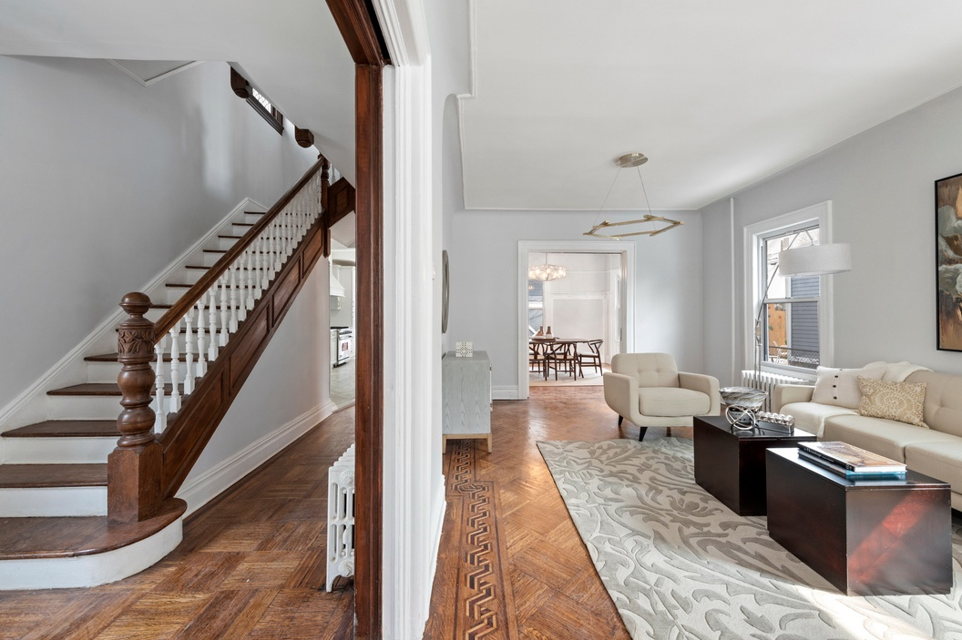 867 EAST 21ST STREET - $1,818,000 // 7 Beds // 4.5 Baths // 2,561 SQFTA thoughtfully restored single-family house nestled on a lush, tree-lined street in Ditmas Park, this immaculate 3-story home is a seamless blend of contemporary chic and prewar charm. Features include 7 bedrooms, 3.5 bathrooms, original hardwood floors with intricate border detailing, a beautiful staircase with carved newels, bay windows, a pretty blue façade, a spacious front yard, a veranda, a finished basement, a private driveway with room for 2-3 cars, and a gut-renovated fully livable garage complete with both a full bathroom and a fully-equipped kitchen on the second floor.
