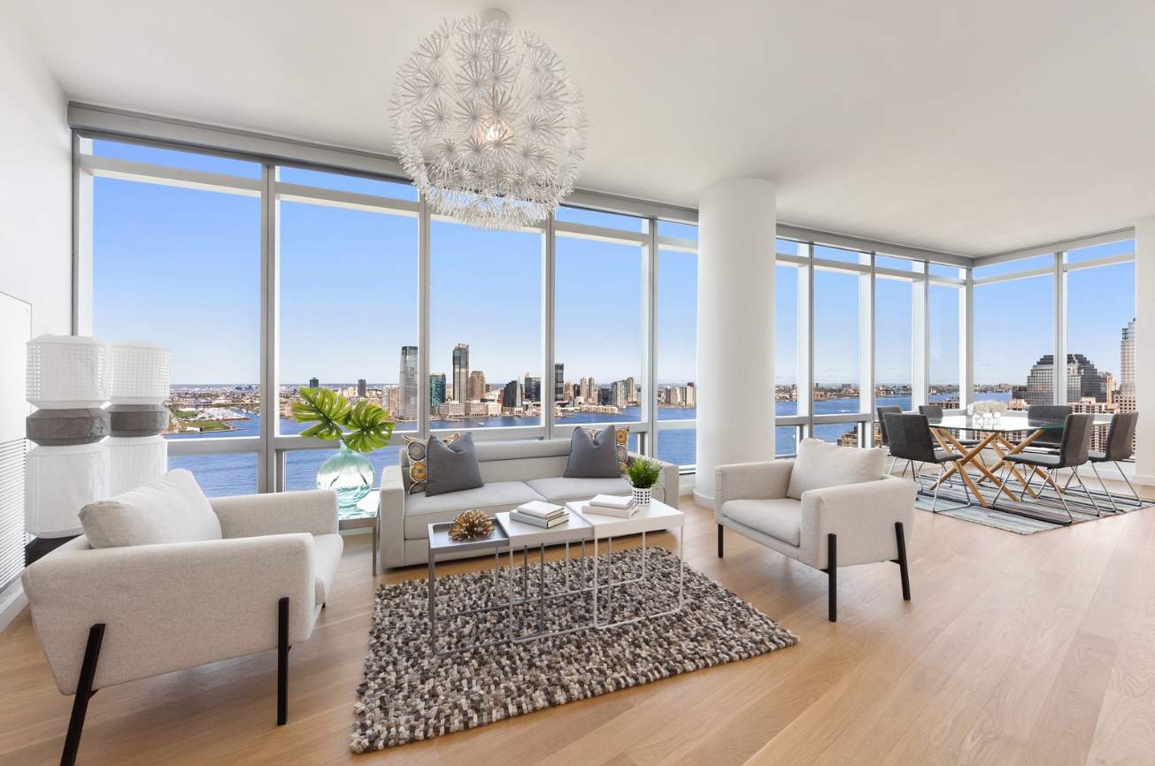 10 WEST STREET, PHA - $3,695,000// 3 Beds // 5 Baths // 2,000 SQFTEverything about this home feels luxurious! You will feel as though you are floating on water with you enter the expansive 32-foot living room, which is wrapped in wall-to-wall floor-to-ceiling windows with northern and western exposure and unobstructed and protected views of the Hudson River. Imported Laudi lacquer doors and white oak hardwood floors bounce light and create an open and airy feeling throughout.