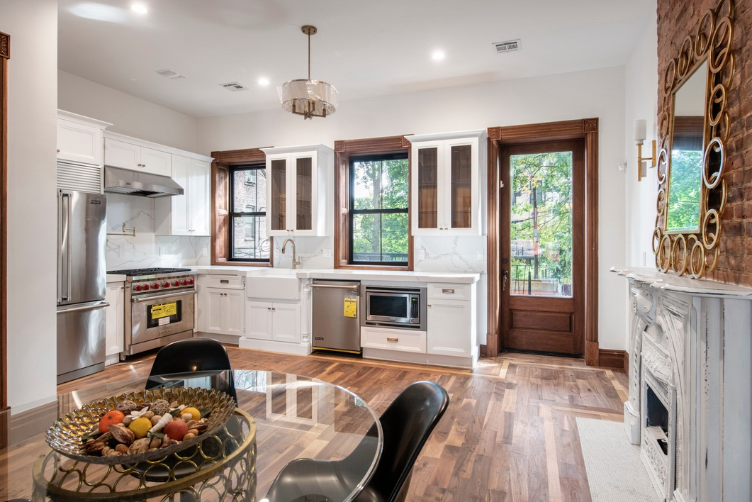 692 MADISON STREET - $1,999,000 // 5 Beds // 3.5 Baths // 3,200 SQFTA gut-renovated two-family brownstone townhouse nestled along a picturesque, tree-lined street in Bedford-Stuyvesant, 692 Madison blends contemporary finishes with a host of charming original details. Features of the home include a classic brownstone façade, tall windows with northern and southern exposure, hardwood floors, exposed brick walls, a wood-burning fireplace, an enclosed backyard, a finished cellar, a gorgeous owner's duplex, and an income-producing rental unit.