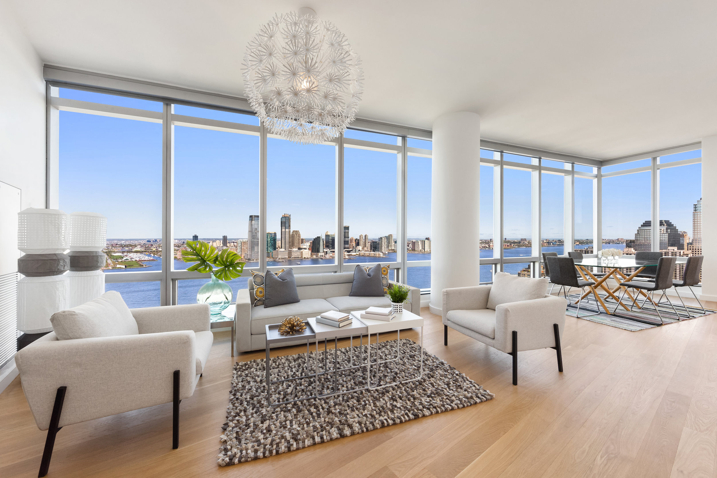 10 WEST STREET, PH1A - $3,695,000 // 3 Beds // 3 Baths // 2,000 SqFtEverything about this home feels luxurious! You will feel as though you are floating on water with you enter the expansive 32-foot living room, which is wrapped in wall-to-wall floor-to-ceiling windows with northern and western exposure and unobstructed and protected views of the Hudson River.