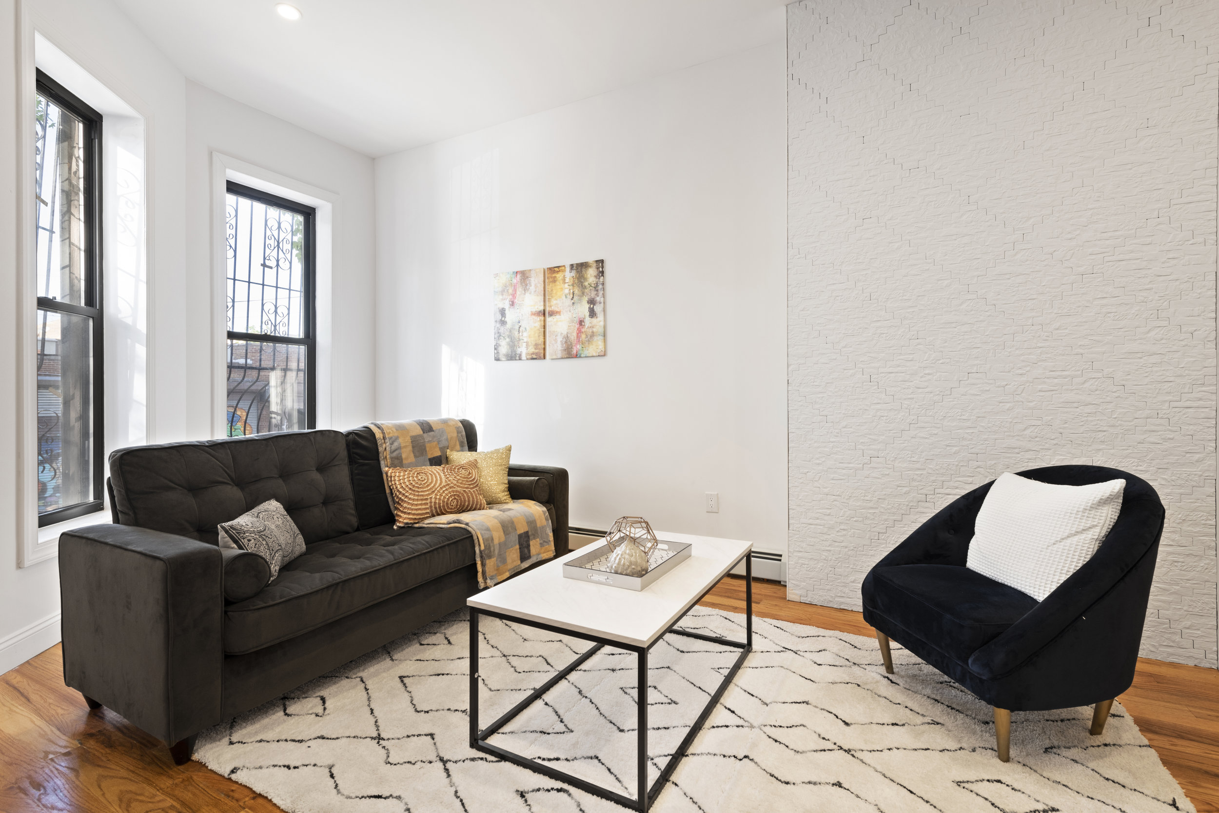 318 VAN BUREN STREET - $1,299,000 // 6 Beds // 3.5 Baths // 2,246 SQFTA beautiful two-family townhouse nestled on a tree-lined street in Bedford-Stuyvesant, 318 Van Buren is a paradigm of classic Brooklyn living. Features of this 2,246 sq. ft. home include a charming redbrick façade, gorgeous hardwood floors, a finished basement, a lush backyard, a lovely 4-bedroom, 2.5-bathroom owner's duplex with a washer/dryer, and an income-producing rental unit.