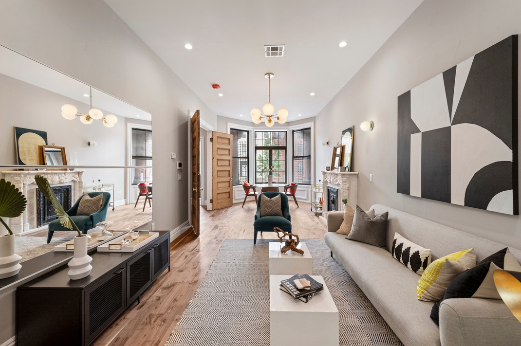 153 HERKIMER STREET - $2,999,000 // 7 Beds // 4.5 Baths // 3,626 SQFT // 2,000 EXT SQFTA gut-renovated & restored two-family townhouse boasting a gated parking spot and a garden level rental unit, 153 Herkimer is a seamless blend of contemporary convenience and classic Brooklyn charm. Features of this 3,600 sq. ft. house include a picturesque Victorian-style façade, a finished cellar, walnut hardwood flooring, central heating and cooling, a private backyard with a deck, and a stunning, 5-bedroom, 3.5-bathroom owner's triplex.