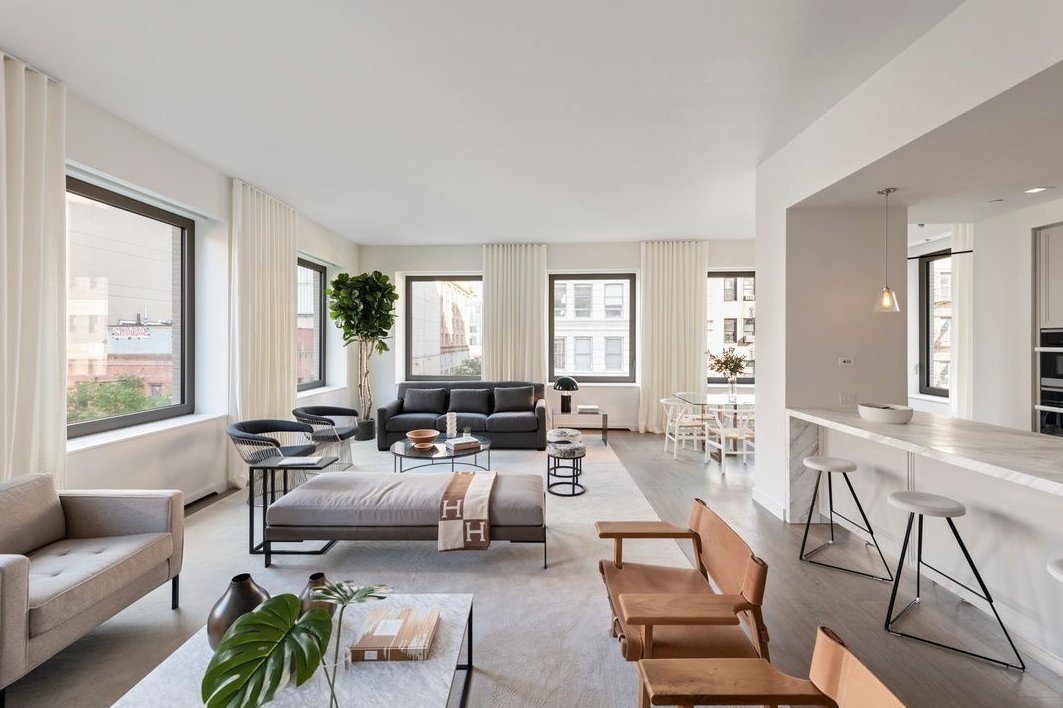 116 UNIVERSITY PLACE, 4 - $7,475,000 // 3 Beds // 3.5 Baths // 3,056 SQFTA palatial full-floor condo located a block away from Union Square, this brand new 3 or 4-bedroom, 3.5-bathroom redefines contemporary Greenwich Village luxury. Features of this 3,056 sq. ft. apartment include engineered wide plank oak flooring, direct elevator entry, 14 oversized windows with northern and eastern exposure, soaring ceilings over 10-ft in height, multi-zone heating and cooling, an open-concept layout, a cozy library, and a large laundry/utility room with a sink and an LG washer/dryer.
