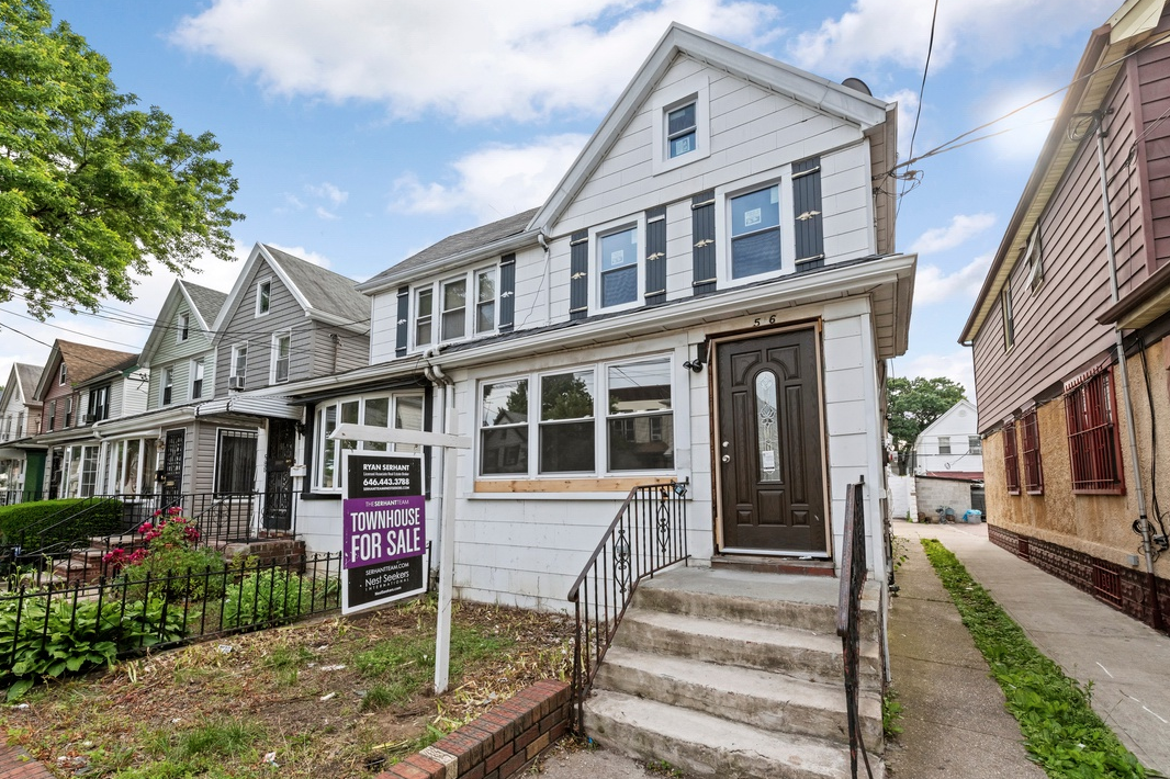 586 EAST 42ND STREET - $669,000 // 3 Beds // 2.5 Baths // 1,671 SQFTA gut-renovated 2-story house nestled on a quiet, tree-lined street in East Flatbush, this beautiful 3-bedroom, 2.5-bathroom home is a portrait of traditional Brooklyn living. Features of this 1,671 sq. ft. home include gorgeous hardwood floors, recessed lighting, brand new sash windows, a charming front lawn, a spacious backyard, a finished basement, a shared driveway, and a private garage.