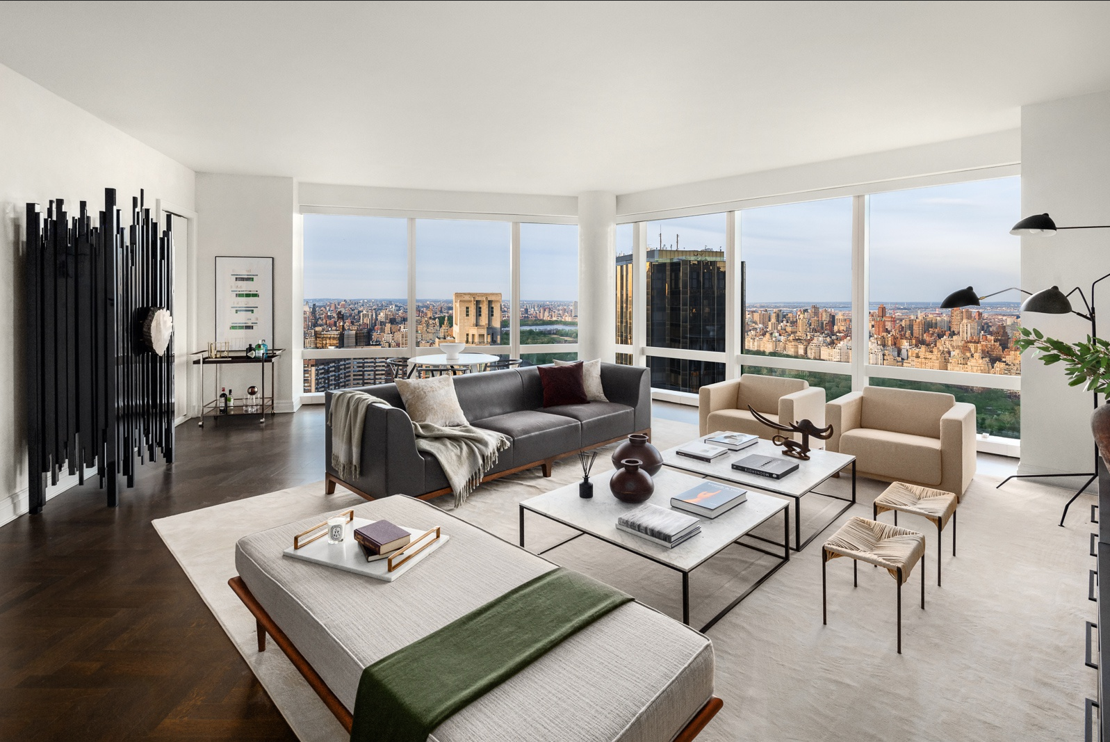 25 COLUMBUS CIRCLE, 68AF - $15,700,000 // 5 Beds // 5.5 Baths // 4,050 SQFTA palatial corner condo graced with breathtaking views of Central Park, the Hudson River, the Statue of Liberty, and the city skyline, this 5-bedroom, 5.5-bathroom home is a paragon of contemporary Manhattan luxury. Features of this 4,050 sq. ft. apartment include gorgeous hardwood floors, floor-to-ceiling windows with northern, eastern, and western exposure, a butler's pantry equipped with a kitchenette, and a pair of convenient in-home washers/dryers.