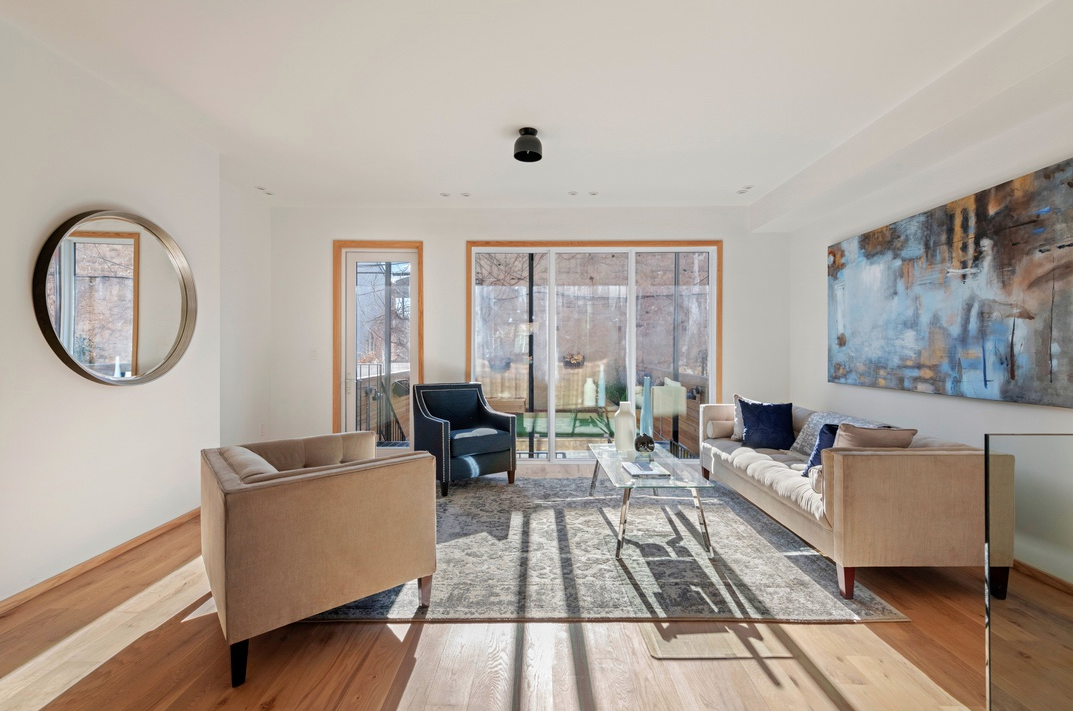 392 FENIMORE STREET - $1,590,000 // 5 Beds // 3.5 Baths // 2,880 SQ FTThis gut-renovated two-family townhouse nestled on a picturesque street in Prospect-Lefferts Gardens, 392 Fenimore is an exemplar of contemporary Brooklyn living. Features of the home include gorgeous hardwood floors, central heating and cooling, a front garden, a spacious backyard with built-in planters and seating, a large rooftop deck with neighborhood views, floating staircases, an in-home washer/dryer, and a flexible layout that allows for either an owner's duplex or triplex as well as an income-producing rental unit.