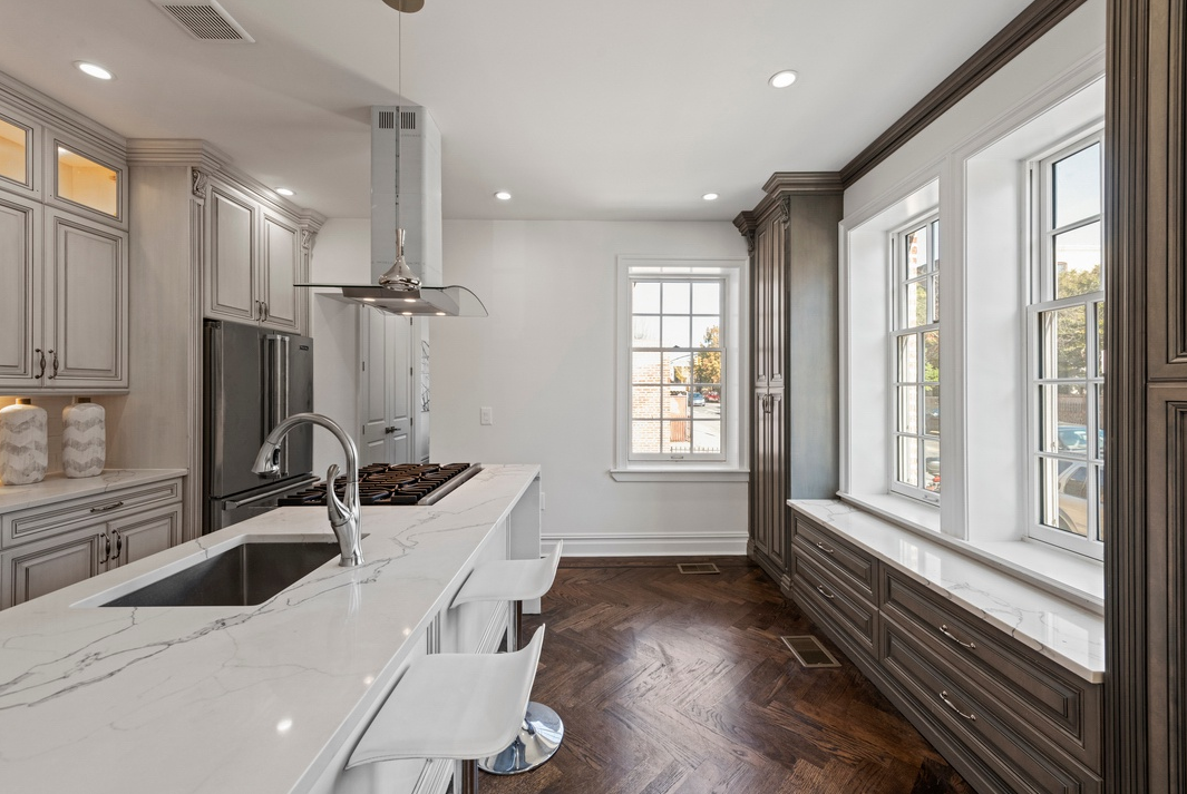 1914 BEDFORD AVENUE - $2,350,000 // 4 Beds // 3.5 Baths // 2,950 SQ FTA gut-renovated semi-detached house nestled on a corner lot in the exclusive Prospect-Lefferts Gardens Historic District, this home is a seamless blend of contemporary luxury and traditional charm. Features of this 2,950 sq. ft. home include a private one-car garage, a lush wraparound garden, a terrace, a gas-burning fireplace, restored herringbone hardwood floors, a gorgeous central staircase, and a windowed basement with a washer/dryer.