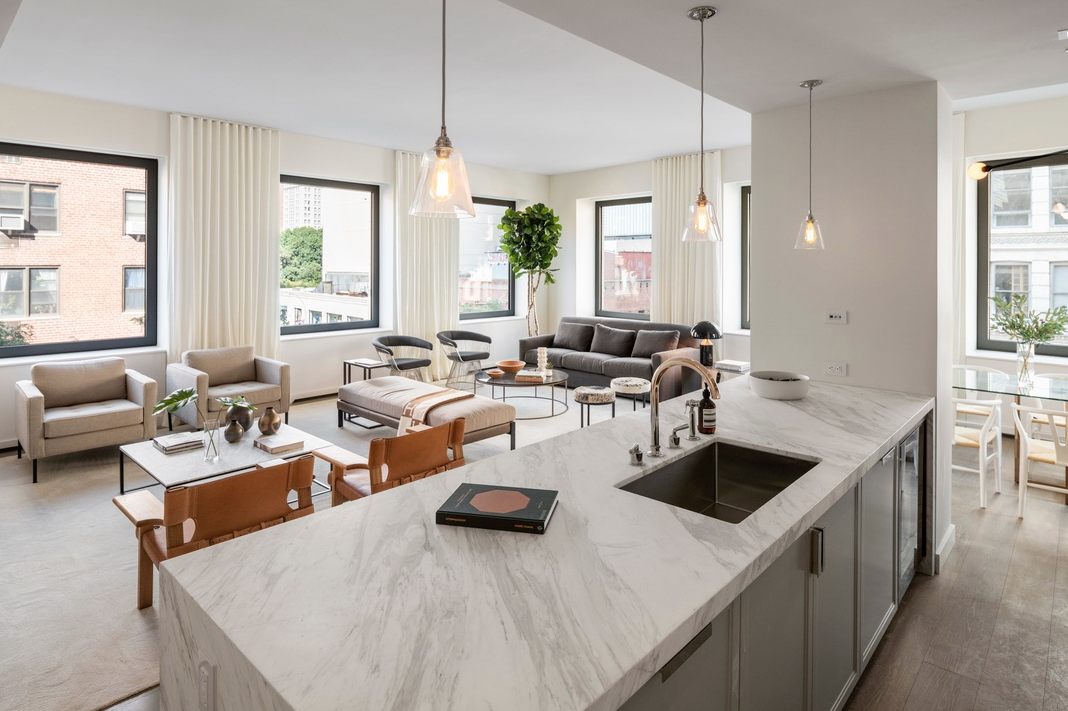 116 UNIVERSITY PLACE, 2 - $6,750,000 // 3 Beds // 3.5 Baths // 3,056 SQ FTA palatial full-floor condo located a block away from Union Square, this brand new 3 or 4-bedroom, 3.5-bathroom redefines contemporary Greenwich Village luxury. Features of this 3,056 sq. ft. apartment include engineered wide plank oak flooring, direct elevator entry, 14 oversized windows with northern and eastern exposure, soaring ceilings over 10-ft in height, multi-zone heating and cooling, an open-concept layout, a cozy library, and a large laundry/utility room with a sink and an LG washer/dryer.