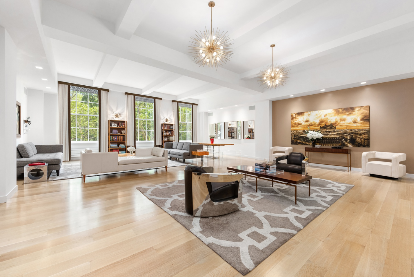 21 EAST 26TH STREET, 3 - $15,950,000 // 4 Beds // 5.5 Baths // 4,967 SQFTA lavish floor-through condo graced with sublime finishes and direct views of Madison Square Park. Features of this apartment include gorgeous wide-plank rift-oak flooring, soaring beamed ceilings, central heating and cooling, a Crestron smart home system, key-locked elevator access, a laundry room with a huge linen closet and a side-by-side washer/dryer, and beautiful sash windows with northern, southern, and western exposure.