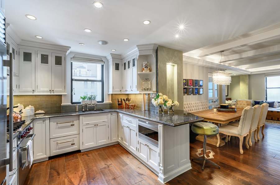 212 EAST 48TH STREET, 8AB - $2,599,000 // 3 Beds // 2 Baths // 2000 SQFTAn enchanting newly renovated co-op nestled between Grand Central Station and the United Nations. Features of this 2,000 sq. ft. apartment include gorgeous wide plank walnut floors, beamed ceilings with crown molding, Venetian plaster walls, quadruple exposure, a spacious laundry room with a linen closet and a side-by-side washer/dryer, and a pair of wood-burning fireplaces.