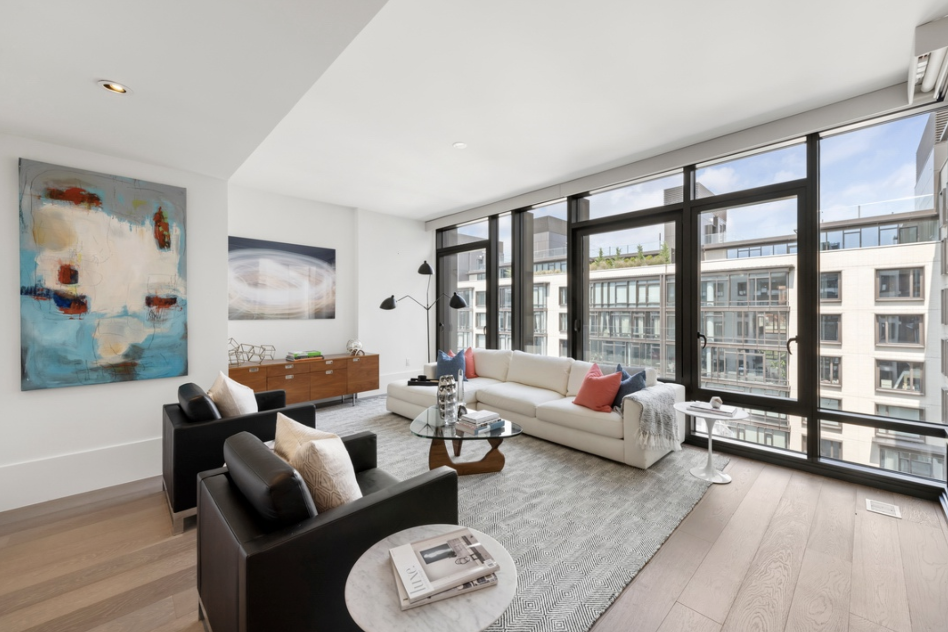 429 KENT AVENUE, D715 - $2,500,000 // 4 Beds // 4.5 Baths // 2,557 SQFTA sterling duplex condo boasting high-end upgrades and a thoughtful floorplan, this massive home is a study in contemporary Brooklyn luxury. Features of this 2,557 sq. ft. apartment include elegant 10-inch wide-plank flooring, huge casements windows overlooking a tranquil courtyard, a 5-zone HVAC system, motorized Lutron blackout blinds, a supersized LG washer/dryer, and a state-of-the-art Nest camera and security system.