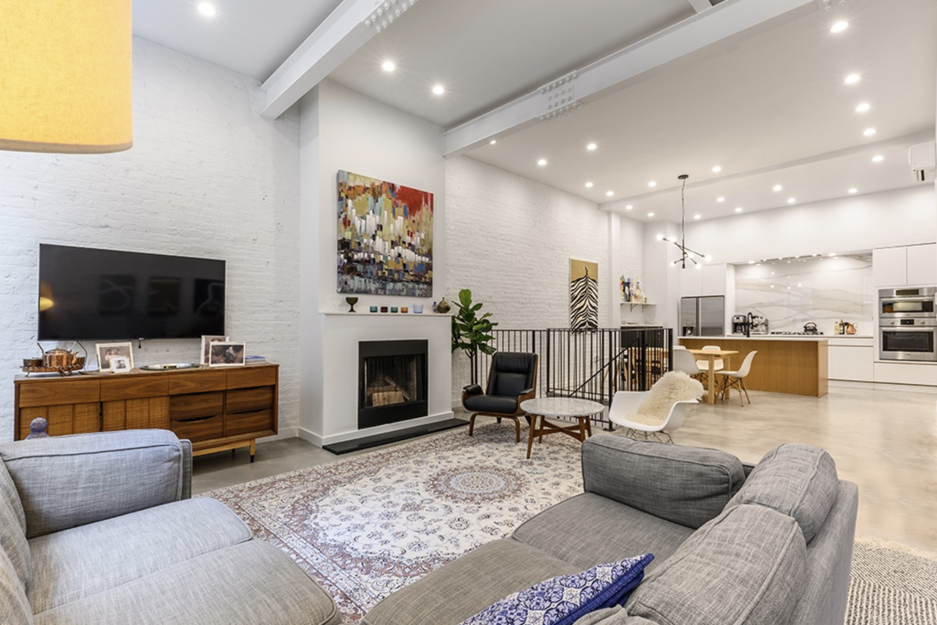 159 CARLTON AVENUE, 1C - $2,399,000 // 2 Beds // 2 Baths // 1,705 SQFTA gut-renovated duplex condo nestled just a block from Fort Greene Park, this stunning home features polished concrete and engineered oak flooring, 12' ceiling height, brand new aluminum sash windows, veneered solid core wood doors with hidden EZ jambs, whitewashed brick walls and exposed I-beams, a ducted wood-burning fireplace, a Mitsubishi split-system with Hyper Heat Technology, Lutron lighting, a Finnish-style sauna with red oak, and a stacked washer/dryer.