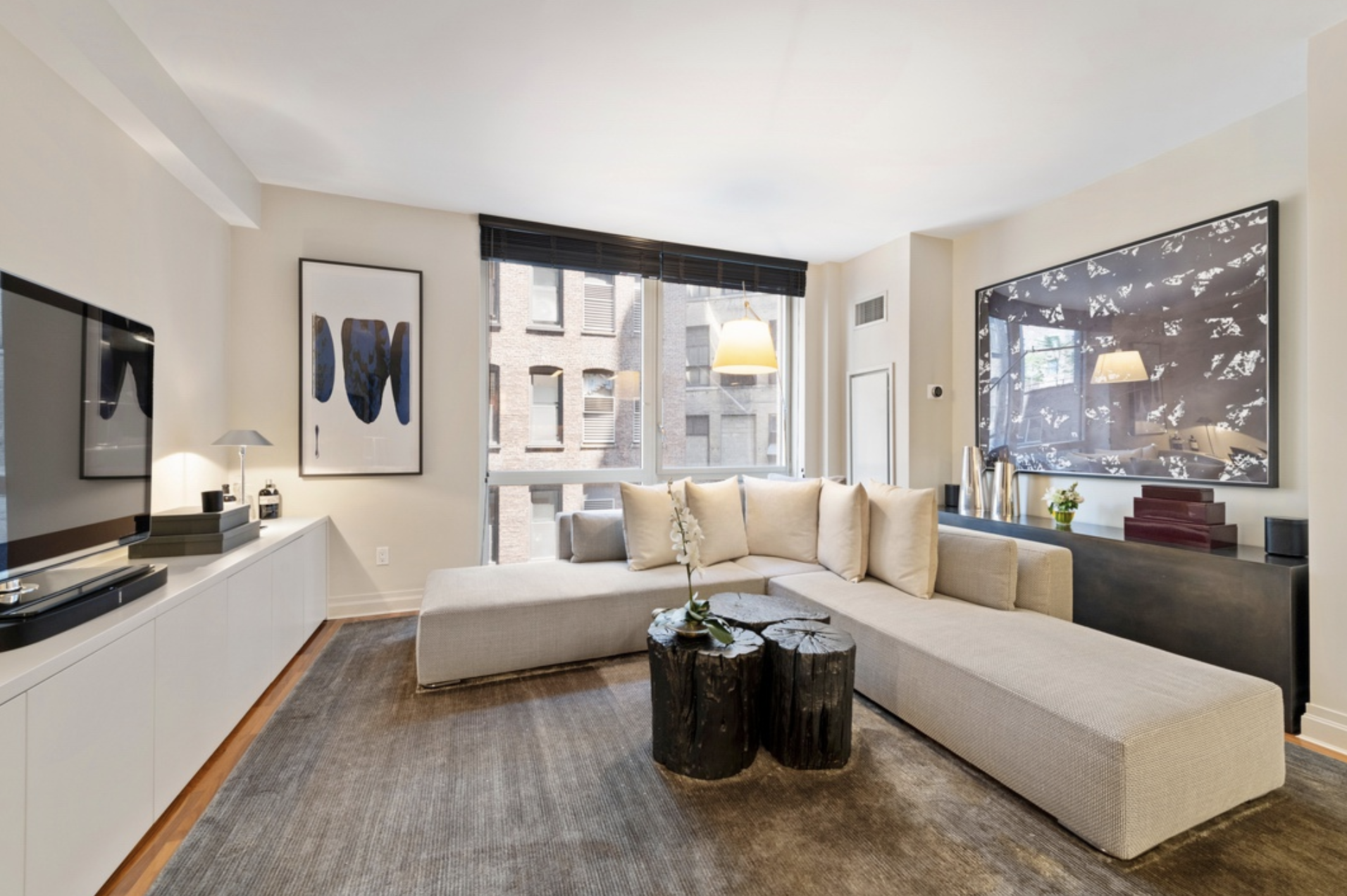 39 EAST 29TH STREET, 11D - $1,350,000 // 1 Beds // 1 Baths // 792 SQFTA pristine NoMad condo boasting an array of chic fixtures and finishes, this home blends warm, organic textures with contemporary lines and functionality. Features of this 792 sq. ft. apartment include gorgeous teak flooring, floor-to-ceiling windows with northern exposure, central heating and cooling, custom built-ins, and a convenient in-unit washer/dryer.