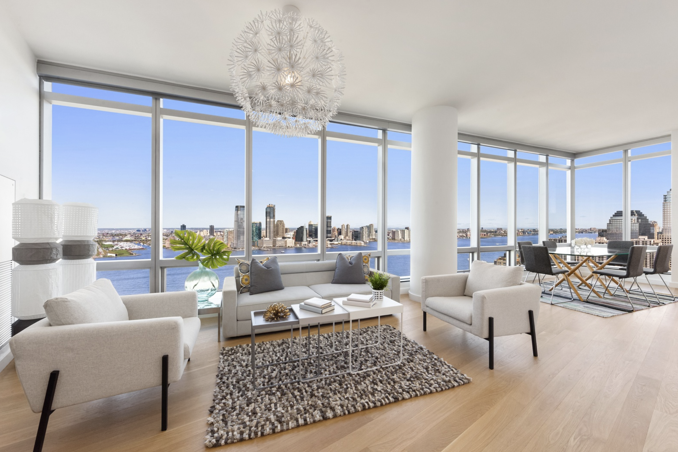10 WEST STREET, PH1A - $3,695,000 // 3 Beds // 3 Baths // 2,000 SQFTStunning Battery Park penthouse with panoramic Hudson River views perched atop The Ritz-Carlton Residence. Everything about this home feels luxurious! You will feel as though you are floating on water with you enter the expansive 32-foot living room, which is wrapped in wall-to-wall floor-to-ceiling windows with northern and western exposure and unobstructed and protected views of the Hudson River.