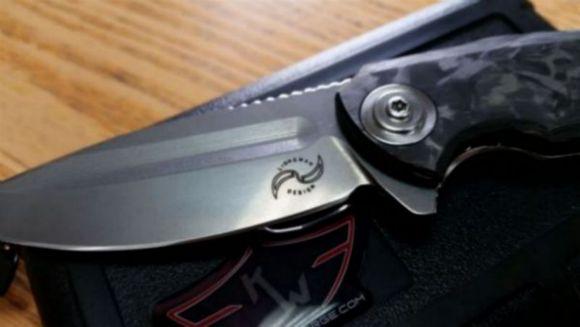 Knife Metal Marked Logo.jpg