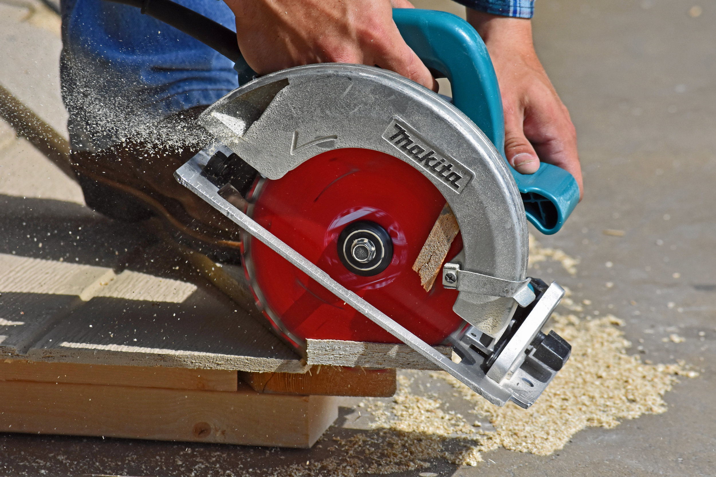 Craftsman is cutting wood that will be used to build a storage building. Manufactured in the USA and delivered right to your home in or near Las Vegas Nevada.
