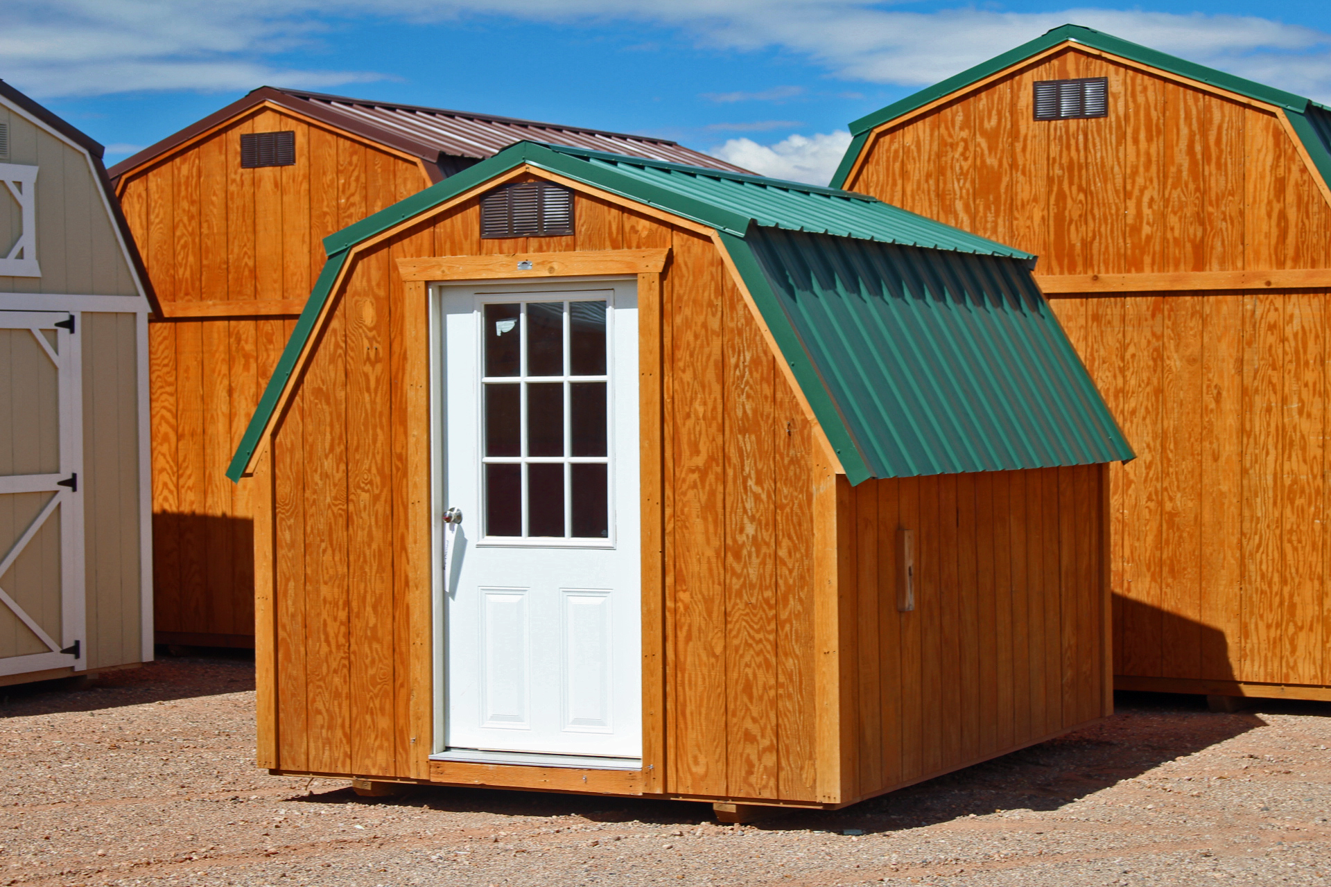 Stained Siding with Green Metal Roof