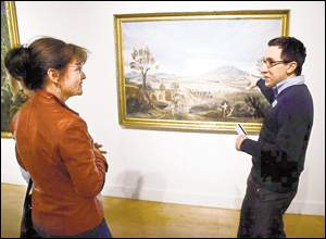 El Paso Museum of Art  interim head of education Ben Fyffe and Tracy Trousset talked Tuesday about the painting by 19th-century artist Leon Trousset.  PHOTO CREDIT: Victor Calzada - El Paso Times